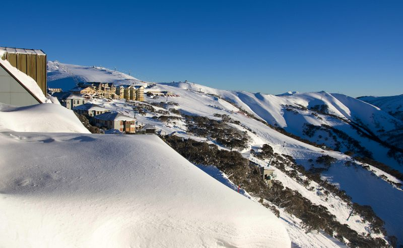 Mt Hotham village after fresh snow on a clear winter's day.