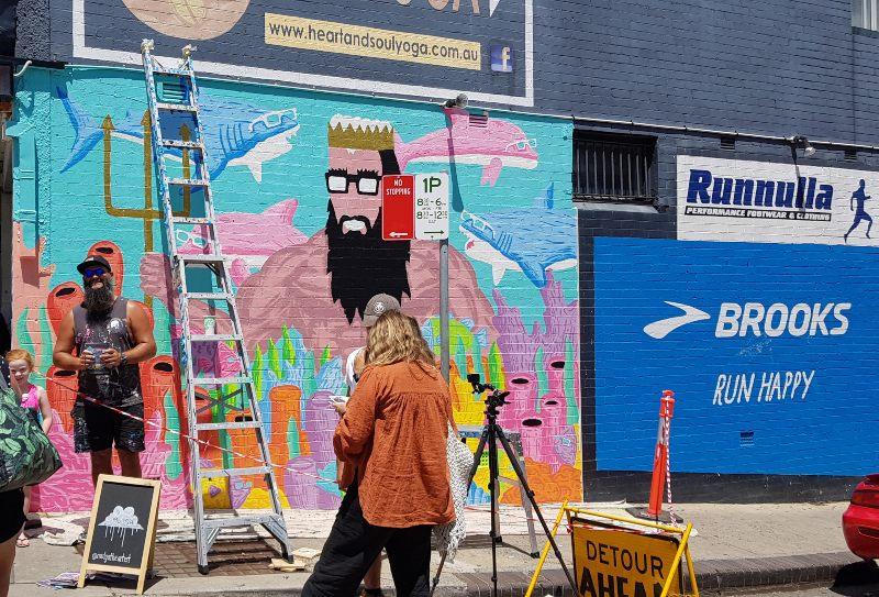 Australian Street Artists Mulga with his mural in Cronulla