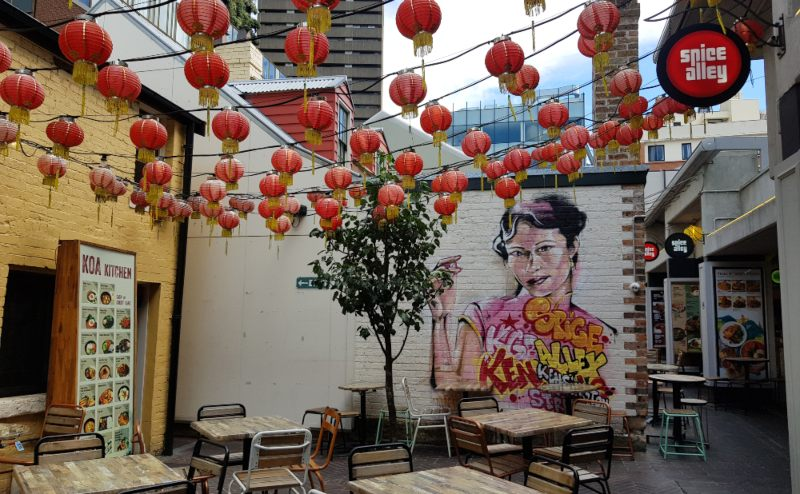 spice alley with mural of woman Sydney